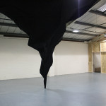DEEP THROAT. Installation by Rich White using timber and blackout cloth. Commissioned by g39 for Barnraising & Bunkers, 2013